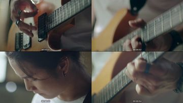 弹吉他的长发帅哥