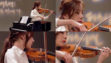 拉小提琴的气质美女