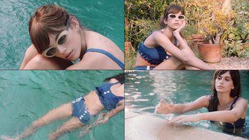 游泳的精致混血美女